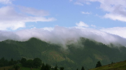 Cloud over  mountain in  summer day. Time lapse
