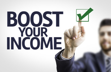 Business man pointing the text: Boost Your Income