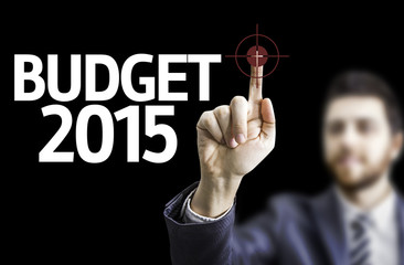 Business man pointing the text: Budget 2015