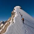 Leinwanddruck Bild - Climbing a mountain