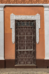 Brown door of a colonial house in Trinidad, Cuba
