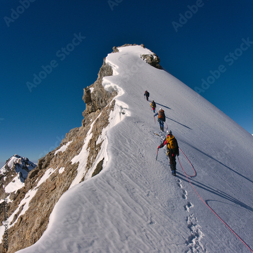 Foto op Canvas Europa Climbing a mountain
