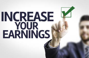 Business man pointing the text: Increase Your Earnings