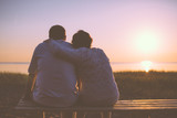 Senior couple enjoy the sunset together poster