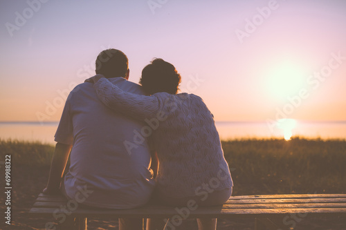 Fototapeta Senior couple enjoy the sunset together
