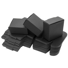 Foldable black paper boxes. Isolated
