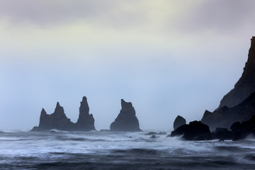 View on three rock pillars at Vik.