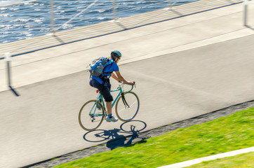Commuter Riding a Bike on a Cycle Path