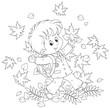 Joyful schoolboy throws up autumnal leaves