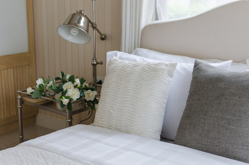 bed and white pillows with lamp