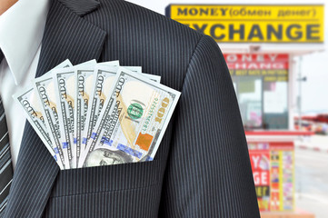 Money in pocket - money exchange concept