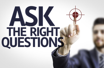 Business man pointing: Ask The Right Questions