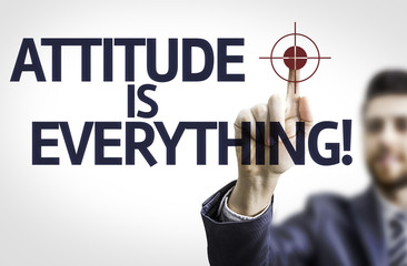 Business man pointing the text: Attitude is Everything!