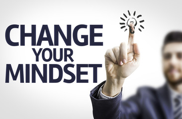 Business man pointing: Change Your Mindset
