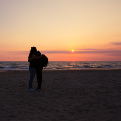 couple hug with beautiful sunset background