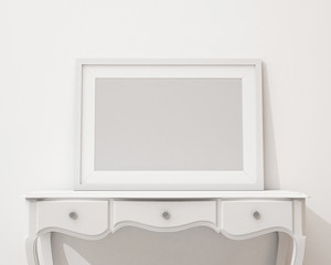 blank picture frame on the white desk and wall