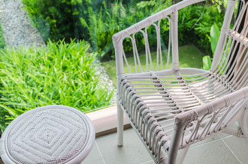 rattan chair with garden view
