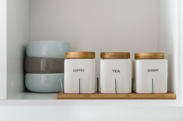sugar tea and coffee bowl in pantry shelf