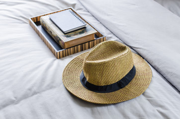 straw hat on bed