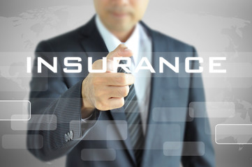 Businessman hand pointing to INSURANCE word on virtual screen
