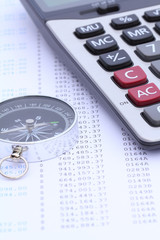 Calculator and compass on bank statement