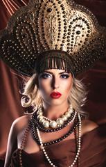 Russian Beauty. Attractive female wearing in kokoshnik. Woman's