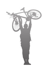 Silhouette of man to rise above a bike