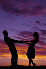 silhouette couple dance lean back