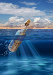 Message in bottle floating on open sea