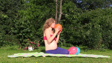 pregnant girl spend free time green park with colorful balloon