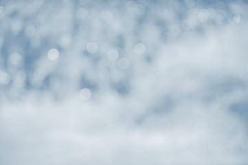 white defocused lights against a blue background