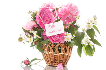 beautiful bouquet of peonies and jasmine in a basket