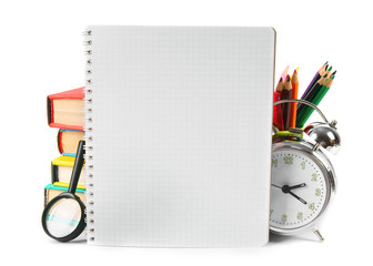 Notebook and school accessories. On white background.