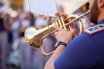 Man playing a trumpet during a concert.
