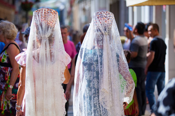Two women wearing a spanish shawl, in andalusia.