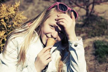 Teenage girl eating an ice cream
