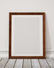 blank wooden picture frame on the wall and the floor