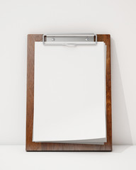 blank wooden clipboard ion the white wall and floor