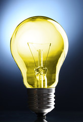 Color light bulb on dark background