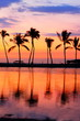 Paradise beach sunset with tropical palm trees
