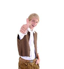 Teenager in bayerischer Tracht und Daumen hoch