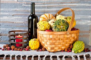 Autum crop. Many pumpkins in wicker basket.