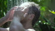 Man getting wet in the shower, slow motion shot at 120fps