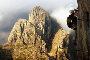 climber on via ferrata or klettersteig in Italy