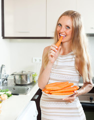 Pregnant woman eating carrot