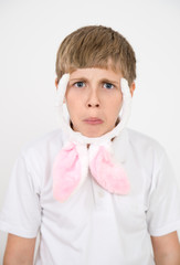 boy with rabbit ears makes faces