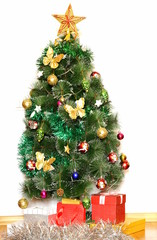 big Christmas tree with decorations and gifts