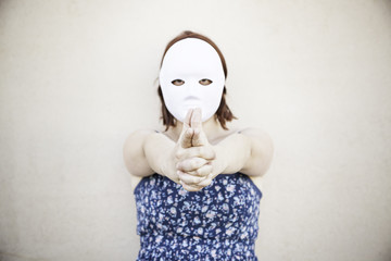 Girl with mask pointing