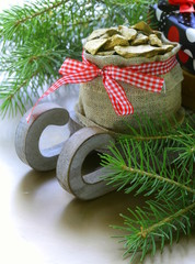 Christmas composition - wooden sleigh with gifts and fir tree