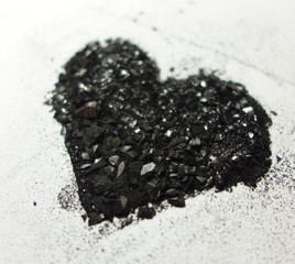 Shimmering heart made from graphite dust from perspective